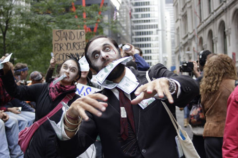 Occupy Wall Street protestor in zombie costume