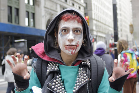 Occupy Wall Street protester in zombie costume